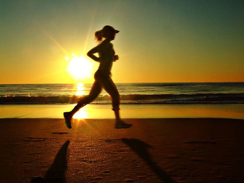 Girl running in sunrise